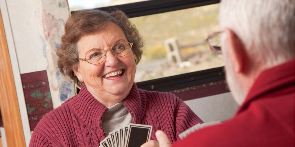 older lady playing cards