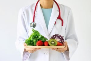 Doctor holding healthy food